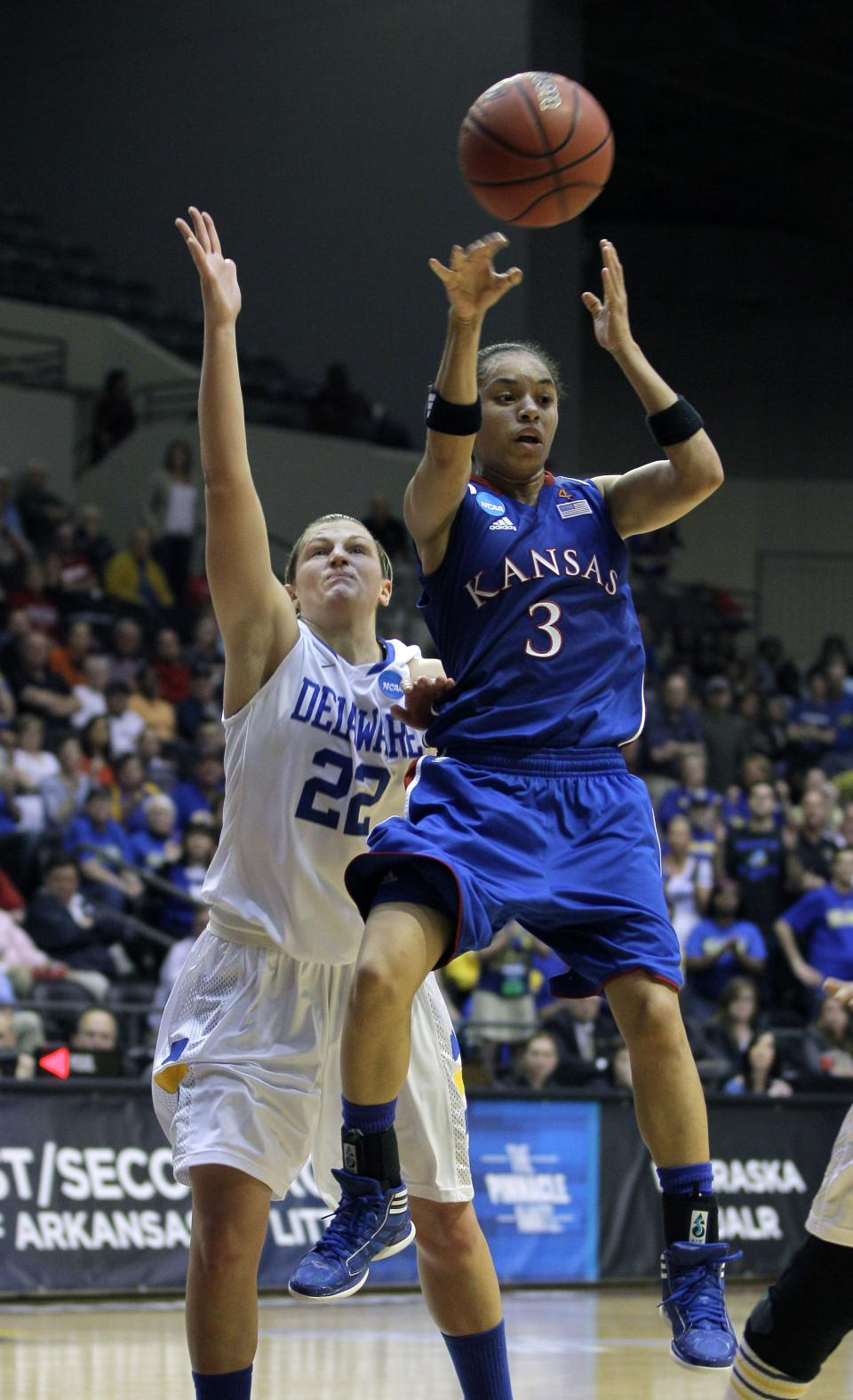 Kansas' Angel Goodrich (3) passes over Delaware's Lauren Carra (22) during the second half of an NCAA tournament second-round women's college basketball game in Little Rock, Ark., Tuesday, March 20, 2012. Kansas won 70-64. (AP Photo/Danny Johnston)