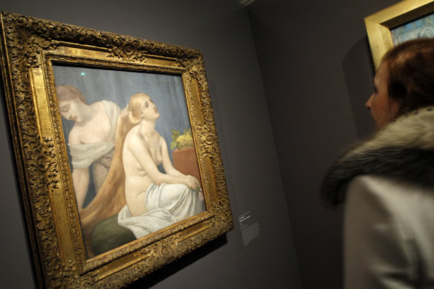 "A woman watches ""La toilette"", a painting by Pierre Puvis de Chavannes as part of the exhibition "" Degas and the Nude"" in Paris, Monday, March 12, 2012. This exhibition has been organised by the Musee d' Orsay and the Museum of Fine Arts, Boston, and takes place from March 13 to July 1, 2012. (AP Photo/Christophe Ena)"