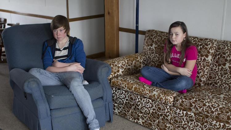 CORRECTS SPELLING TO PERSYN NOT PERSON James Persyn III, left, 14, and his 11 year-old sister Acelin were in their Lincoln Township home with their 2 year-old brother when the CMU student that was abducted by Eric Ramsey got away from Ramsey's vehicle and banged on the door of the Persyn residence for help, Wednesday, Jan. 16, 2013. James let the woman in, locked the door, grabbed his hunting knife, and moved her, his siblings, and the family dog into the bathroom while the woman used James' phone to call the police. While the four were shut in the bathroom, Ramsey attempted to light the house on fire and then left. (AP Photo/The Saginaw News, Colleen Harrison)
