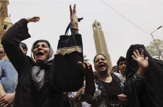 Women shout slogans against Egyptian President Mursi and members of the Muslim Brotherhood in front of Cairo's main Coptic cathedral