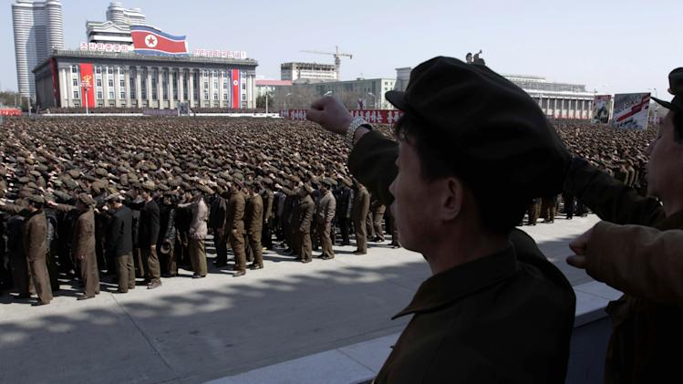 North Koreans punch the air during a rally at Kim Il Sung Square in downtown Pyongyang, North Korea, Friday, March 29, 2013. Tens of thousands of North Koreans turned out for the mass rally at the main square in Pyongyang in support of their leader Kim Jong Un's call to arms. (AP Photo/Jon Chol Jin)