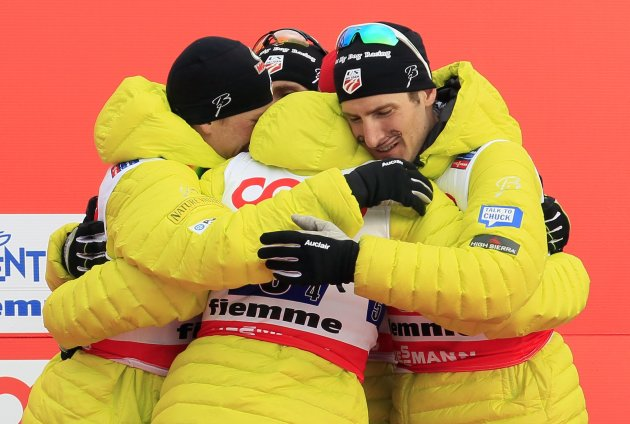 Team U.S. skiers celebrate their bronze medal in the Nordic Combined Team Gundersen competition at the Nordic Ski World Championships in Val di Fiemme