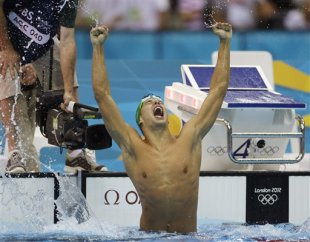 South Africa's Chad le Clos reacts as he wins gold in the men's 200-meter butterfly (AP)