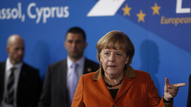 German Chancellor Angela Merkel gestures as she arrives for a European People's Party (EEP) meeting in Cyprus' southern coastal resort of Limassol in an extraordinary summit on Friday, Jan. 11, 2013. Among the topics of discussion at the meeting hosted by the leader of Cyprus' main opposition Democratic Rally party Nicos Anastasiades will be the EU budget. Anastasiades is currently leading opinion polls as the top contender ahead of the country's Feb. 17 presidential election. Cyprus is in the midst of talks with international lenders on a bailout to rescue its ailing banking sector that sustained massive losses on bad Greek debt and loans. (AP Photo/Petros Karadjias)