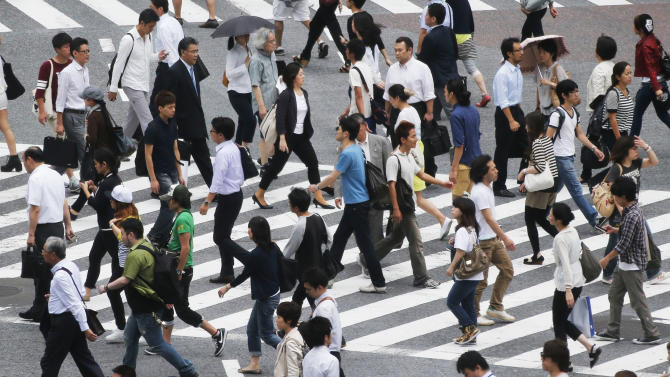 Japan business turns positive after almost 2 years