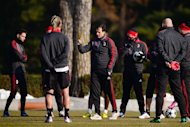 AC Milan coach Massimiliano Allegri talks to his players during a training session on February 19, 2013. After their worst ever start to a league campaign the Rossoneri have climbed to third place and within touch of securing one of the three Champions League places for next year