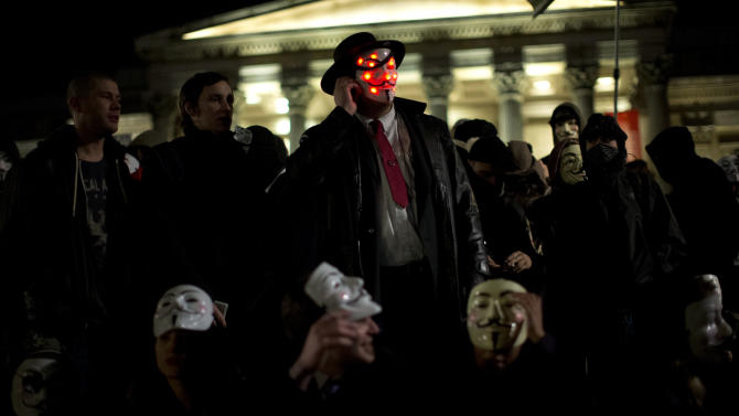 Anonymous supporters wearing Guy Fawkes masks gather in Trafalgar Square before the start of a protest march towards Britain's Houses of Parliament in London, Monday, Nov. 5, 2012.  The protest was held on November 5, to coincide with the failed 1605 gunpowder plot to blow up the House of Lords.  (AP Photo/Matt Dunham)