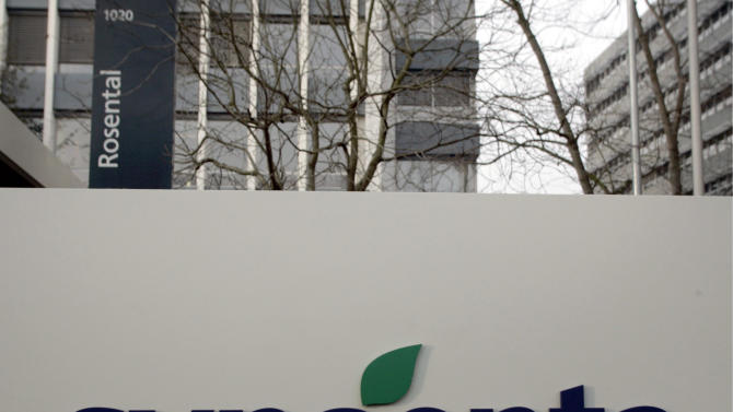 This Feb. 7, 2007, file photo shows the Basel, Switzerland, headquarters and logo of the chemical-maker Syngenta. More than 1,000 U.S. communities and water districts that have spent millions of dollars over many years filtering atrazine, a common agricultural herbicide produced by Syngenta, out of their drinking water are welcoming their shares of a $105 million settlement with the company. Several recipients of the settlement funds, approved by an Illinois federal judge in October 2012, said this week they're mapping out what to do with that money, for now depositing it into their budgets' general fund. (AP Photo/Keystone, Georgios Kefalas, File)