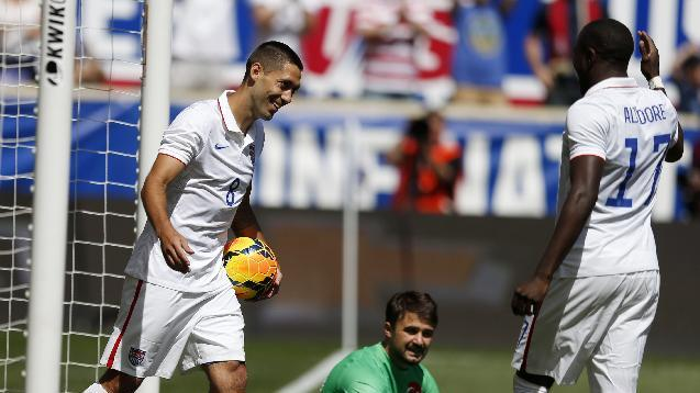 United States' Clint Dempsey, left, celebrates with teammate Jozy Altidore, right, after scoring a goal onTurkey goalkeeper Onur Recep Kivrak, center, in the second half of an international soccer friendly, Sunday, June 1, 2014, in Harrison, N.J. The U.S. won 2-1