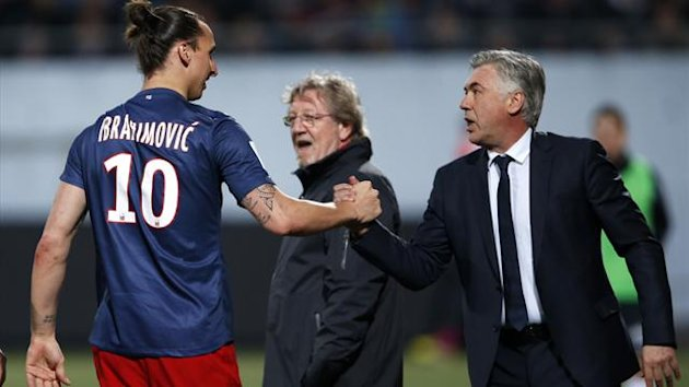 Zlatan Ibrahimovic (L) of Paris Saint-Germain reacts with his then coach Carlo Ancelotti (Reuters)