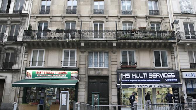 "View of the building where three Kurdish women, including one of the founders of a militant group battling Turkish troops since 1984, were ""executed"" in Paris, Thursday, Jan. 10, 2013. Three Kurdish women, including one of the founders of a militant group battling Turkish troops since 1984, were ""executed"" at a Kurdish center in Paris, the interior minister said Thursday. The news prompted angry crowds of Kurds to flood into the area. It was not immediately clear who killed the women, who belonged to the Kurdistan Workers Party, or PKK, a group that Turkey and its Western allies, including the United States and the European Union, consider a terrorist organization. (AP Photo/Christophe Ena)"