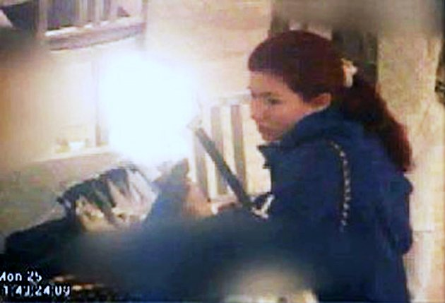 This frame grab image from a surveillance video made and released by the Federal Bureau of Investigation (FBI), and partially obscured by the source, shows Russian spy Anna Chapman in New York. FBI vi