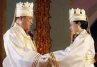 File photo taken in 2002 shows Unification Church founder Sun Myung Moon (L) and his wife Hak Ja Han during a mass wedding ceremony in Seoul. Moon&#39;s death robs his Unification Church of the glue that sustained its global following as a cohesive religious and financial force even as membership dwindled from its 1980s peak, analysts say