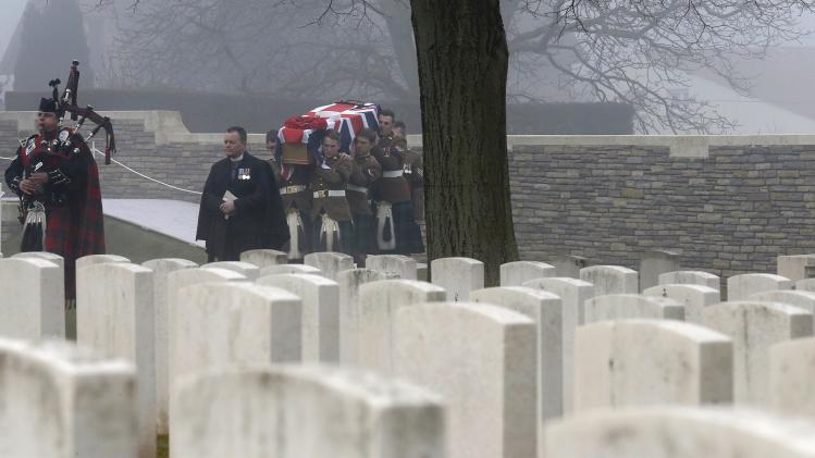 Soldiers of the 2nd Battalion of the Royal Regiment of Scotland carry the coffin of Private William McAleer at a WWI memorial during a reburial ceremony at the Loos-en-Gohelle Commonwealth war cemetery near Lens