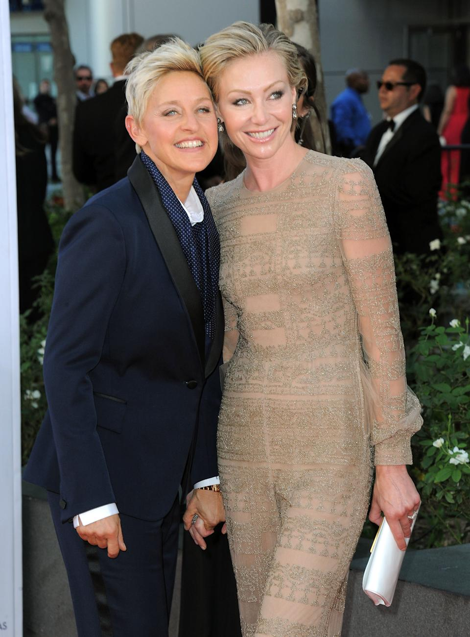 Actresses Ellen DeGeneres, left and Portia de Rossi arrives at the 64th Primetime Emmy Awards at the Nokia Theatre on Sunday, Sept. 23, 2012, in Los Angeles.  (Photo by Jordan Strauss/Invision/AP)