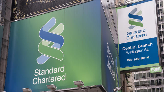 "Standard Chartered reported a sharp fall in pre-tax profits in the third quarter and issued a profit warning, while saying it would ""remain watchful in India, in China"""