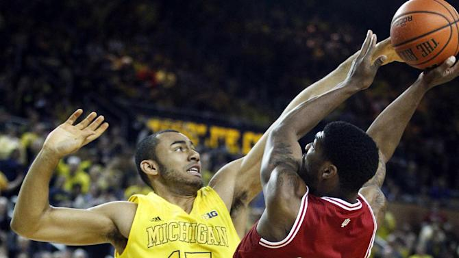 Michigan forward Jon Horford (15) blocks a shot by Indiana guard Remy Abell (23) during the first half of an NCAA college basketball game Sunday, March 10, 2013, in Ann Arbor, Mich. (AP Photo/Duane Burleson)