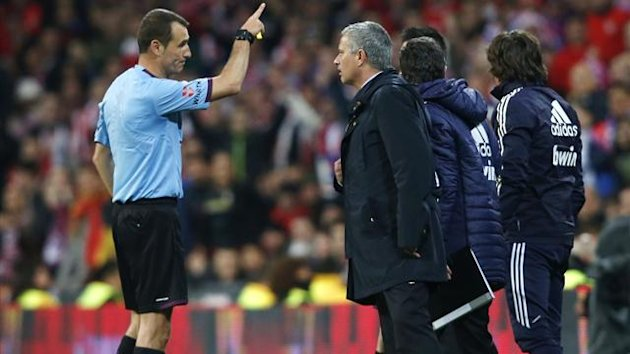 Referee Clos Gomez (L) expels Real Madrid coach Jose Mourinho for protesting