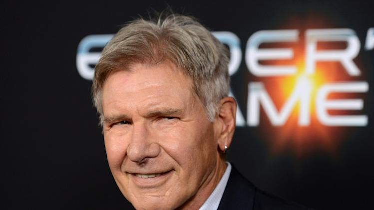 "FILE - This Oct. 28, 2013 file photo shows actor Harrison Ford at the LA Premiere of ""Ender's Game"" in Los Angeles. Disney announced Sunday, July 6, 2014, that shooting will be halted for two weeks in August to adjust the production schedule following Ford's injury. The 71-year-old broke his leg in June during filming of the much-anticipated sequel at Pinewood Studios outside of London. (Photo by Jordan Strauss/Invision/AP, File)"