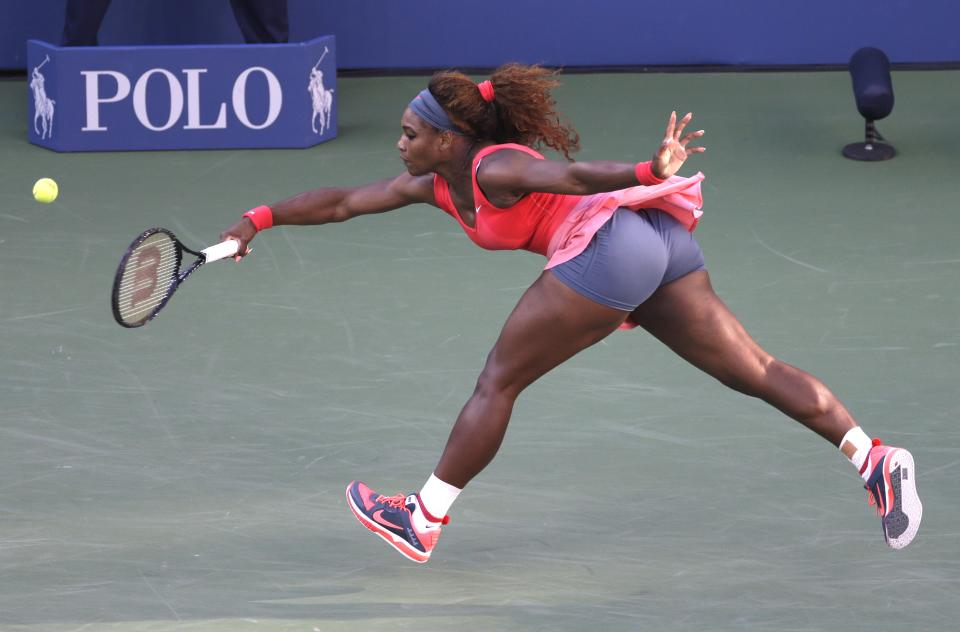 Serena Williams returns a shot against Victoria Azarenka, of Belarus, during the women's singles final of the 2013 U.S. Open tennis tournament, Sunday, Sept. 8, 2013, in New York. (AP Photo/Mike Groll)