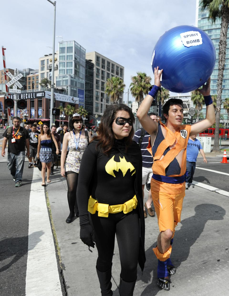 Fans arrive at the San Diego Convention Center before preview night at Comic - Con on Wednesday July 11, 2012, in San Diego.  (Photo by Denis Poroy/Invision/AP)