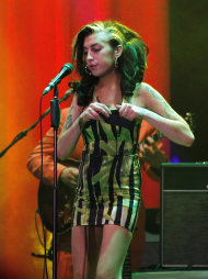FILE - In this June 18, 2011 file photo, Amy Winehouse performs on stage during her concert in Belgrade, Serbia. British police say singer Amy Winehouse has been found dead at her home in London on Saturday, July 23, 2011. The singer was 27 years old. (AP Photo/File)