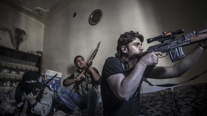 In this Monday, Oct. 29, 2012 photo, a rebel sniper aims at Syrian army positions in the Aleppo Jedida district, Syria. Syrian fighter jets pounded rebel areas across the country on Monday with scores of airstrikes that anti-regime activists called the most widespread bombing in a single day since Syria's troubles started 19 months ago. (AP Photo/Narciso Contreras).