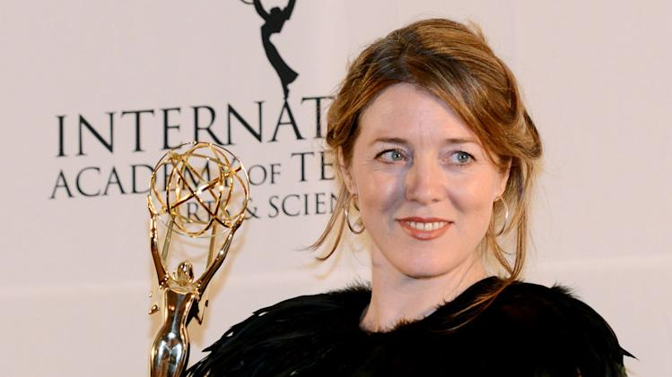 "Annabel Jones of Great Britain holds her emmy after winning the TV Movie/Mini-Series award for ""Black Mirror"" at the 40th International Emmy Awards,  Monday, Nov. 19, 2012 in New York. (AP Photo/Henny Ray Abrams)"
