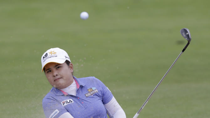 Inbee Park, of South Korea, hits from a bunker near the eighth green during the final round at the U.S. Women's Open golf tournament at Sebonack Golf Club in Southampton, N.Y., Sunday, June 30, 2013. (AP Photo/Seth Wenig)