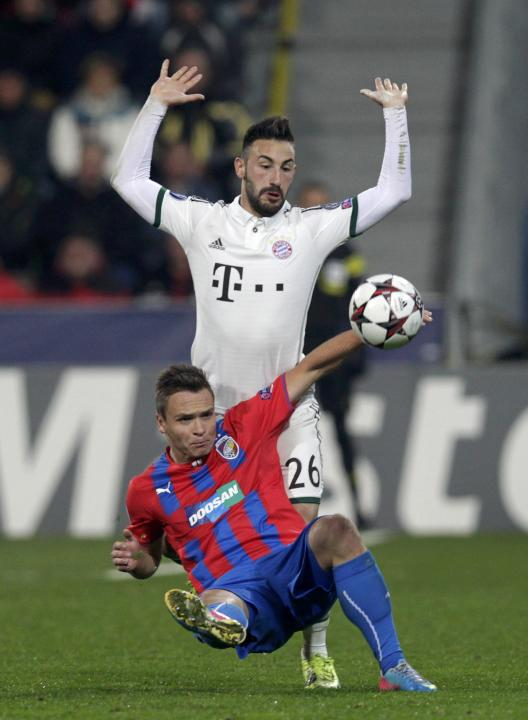 Bayern Munich's Contento reacts in front of Viktoria Plzen's Tecl during their Champions League soccer match in Plzen
