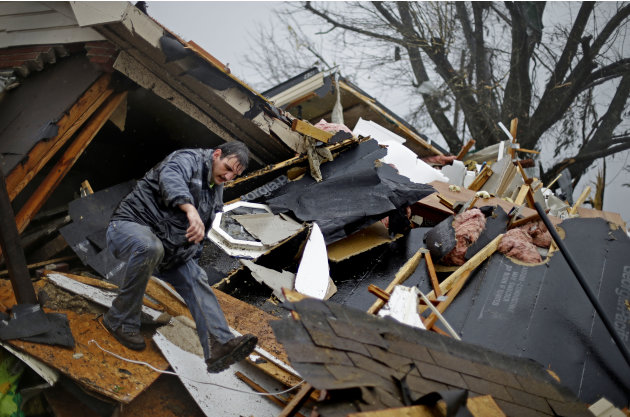 Nathan Varnes, of Cartersville, Ga., helps search a destroyed home for a dog after a tornado struck, Wednesday, Jan. 30, 2013, in Adairsville, Ga. A fierce storm system that roared across Georgia has