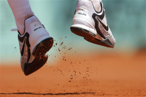 Argentina's Juan Martin del Potro's shoes are seen as he serves to Spain's Albert Montanes during their first round match in the French Open tennis tournament at the Roland Garros stadium in Paris, Sunday, May, 27, 2012. (AP Photo/Bernat Armangue)