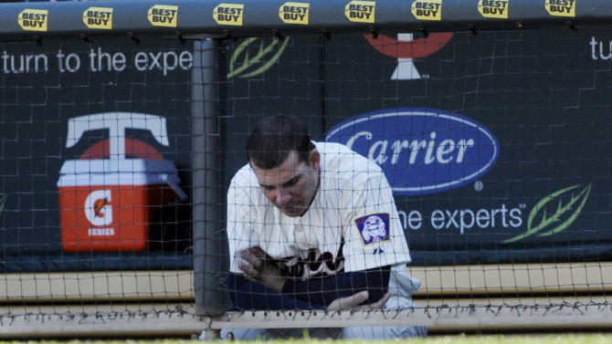 Minnesota Twins third baseman Danny Valencia sits alone in the dugout after the Toronto Blue Jays beat the Minnesota Twins 11-3 in a baseball game Sunday, May 15, 2011 in Minneapolis. It was the Twins' eighth straight loss.  (AP Photo/Jim Mone)
