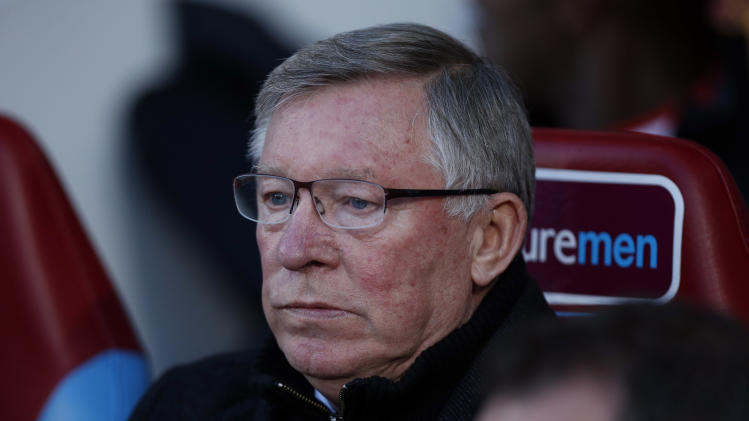 Manchester United's manager Sir Alex Ferguson waits for the start of the English Premier League soccer match between West Ham and Manchester United at Upton Park stadium in London, Wednesday, April 17, 2013.  (AP Photo/Matt Dunham)