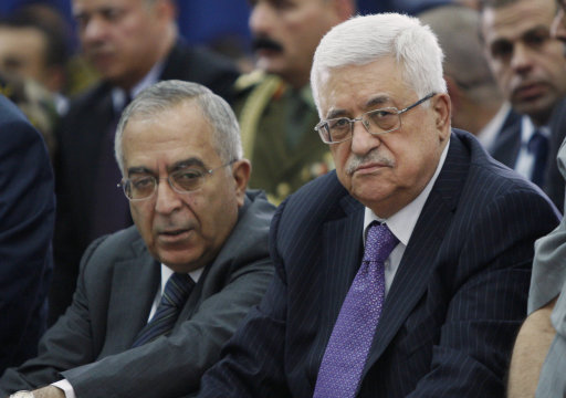 Palestinian President Mahmoud Abbas, right, and Prime Minister Salam Fayyad, left, attend Eid al-Fitr prayers in the West Bank city of Ramallah, Tuesday, Aug. 30, 2011. Eid al-Fitr holiday marks the end of the Muslim holy month of Ramadan.(AP Photo/Majdi Mohammed)