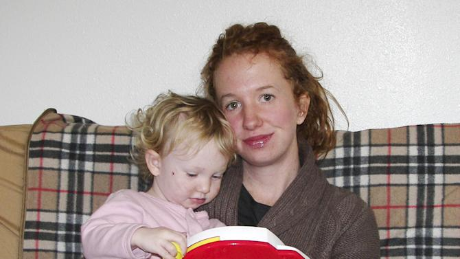 In this undated photo provided by Emily Gillette, she is shown with daughter, River. Gillette, who was asked to leave an airplane for breast-feeding her child in 2006, sparking a day of airport protests nationwide, has reached an out-of-court settlement with the airlines she sued. Gillette of Santa Fe, N.M, says she was kicked off a Delta Connections flight in Burlington, Vt., in 2006 because she wouldn't cover herself with a blanket while nursing her 1-year-old daughter. Gillette had sued Delta Airlines, Freedom Airlines and Mesa Air Group for unspecified compensatory and punitive damages. (AP Photo/Emily Gillette)