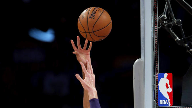 Dallas Mavericks' Brandan Wright, left, shoots against Los Angeles Lakers' Pau Gasol, of Spain, in the first half of an NBA basketball game in Los Angeles, Tuesday, Oct. 30, 2012. (AP Photo/Jae C. Hong)