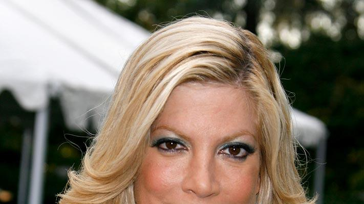 "Tori Spelling arrives at the ""Much Love Animal Rescue Benefit"" at the Playboy Mansion."