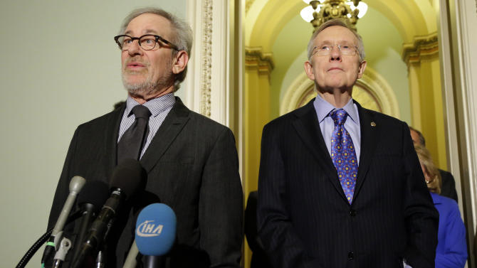 """Director Steven Spielberg, left, speaks during a media availability with Senate Majority Leader Harry Reid of Nevada, right, before a screening of the movie """"Lincoln,"""" for members of Congress, on Capitol Hill, Wednesday, Dec. 19, 2012 in Washington. (AP Photo/Alex Brandon)"""