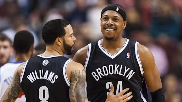 Brooklyn Nets forward Paul Pierce (34) celebrates with guard Deron Williams (8) after being fouled while going up for a shot during the first quarter against the Philadelphia 76ers at the Wells Fargo Center (Reuters)