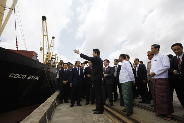 Japan's Prime Minister Shinzo Abe gestures during his visit to the Myanmar International Terminals Thilawa port outside Yangon
