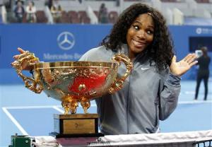 Williams of the U.S. reacts as she poses with the trophy after winning her women's singles final match against Jankovic of Serbia at the China Open tennis tournament in Beijing