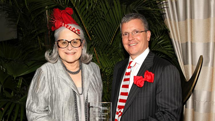 IMAGE DISTRIBUTED FOR READING IS FUNDAMENTAL - Carol H. Rasco, President and CEO of Reading Is Fundamental, presents the Legacy of Literacy Award to Jack Remondi, President and CEO of Sallie Mae, at Reading Is Fundamental's 2014 The Cat In The Hat Gala at the Four Seasons Hotel on Thursday, April 24, 2014 in Washington, DC. (Paul Morigi/AP Images for Reading Is Fundamental)