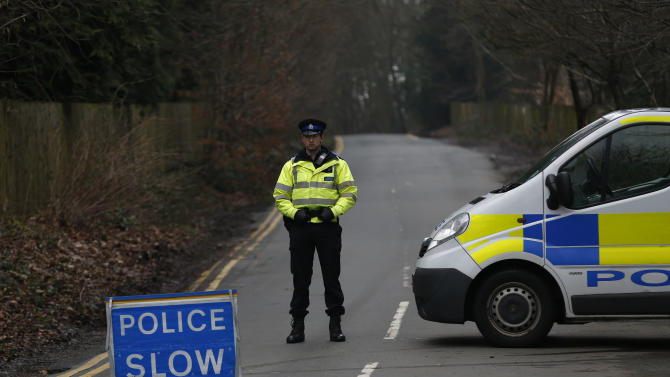 A British police officer stands guard at a cordon off road leading to the residence of Boris Berezovsky in Ascot, a town 40 kilometers (25 miles) west of London, Sunday, March 24, 2013.  Berezovsky, a self-exiled and outspoken Russian tycoon who had a bitter falling out with Russian President Vladimir Putin, was found dead in southeast England on Saturday. He was 67. (AP Photo/Sang Tan)