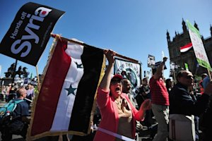 Protesters demonstrate against military intervention…