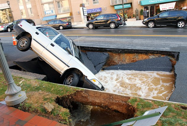 Sink Hole Swallows Car In Chevy Chase, Maryland