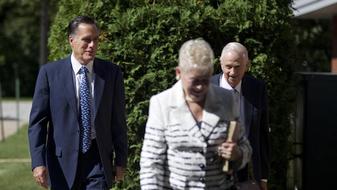Republican presidential candidate, former Massachusetts Gov. Mitt Romney, left, walks towards the Church of Jesus Christ of Latter-day Saints on Sunday, Aug. 19, 2012 in Wolefboro, N.H.  (AP Photo/Evan Vucci)