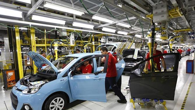 Workers assemble a new Hyundai i10 car at the Hyundai Assan car plant in Izmit, western Turkey
