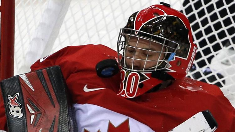 Canada's Watson makes a save during the semi-final sledge hockey game against Team USA at the 2014 Sochi Winter Paralympic Games