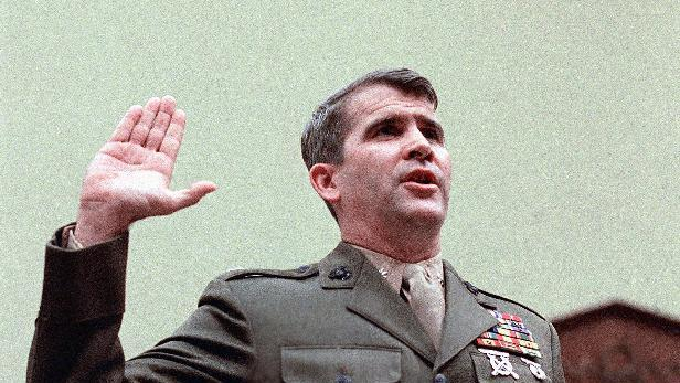 """FILE - In this Dec. 18, 1986 file photo, Oliver North is sworn in on Capitol Hill in Washington prior to testifying before the House Foreign Affairs  Committee. In the never-ending quest to preserve the government's history, there have been plenty of weapons of mass destruction. Before there were """"delete"""" keys on computers, there were paper shredders, """"erase"""" buttons on tape recorders and trash cans. The current dustup over access to Hillary Rodham Clinton's emails as secretary of state is causing historians and government record-keepers alike to take stock of what may be a best-of-times, worst-of-times moment for saving government records.  (AP Photo/J. Scott Applewhite, File)"""